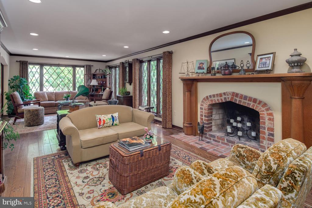 Wood-burning fireplace with brick accents - 2821 N QUEBEC ST, ARLINGTON