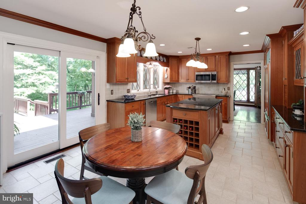 Kitchen opens to multi-tiered decks and yard - 2821 N QUEBEC ST, ARLINGTON