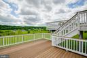 Lower level of the massive rear deck - 15052 BANKFIELD DR, WATERFORD