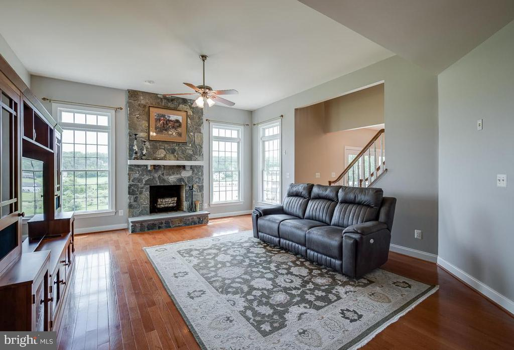 Large family room with stack-stone fireplace - 15052 BANKFIELD DR, WATERFORD