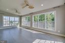 Sunroom with lots of light and 2 ceiling fans - 18460 KERILL RD, TRIANGLE
