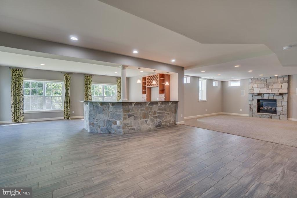 Finished basement with tile and carpet - 18460 KERILL RD, TRIANGLE