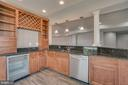Wet bar in basement with dish washer and wine frig - 18460 KERILL RD, TRIANGLE