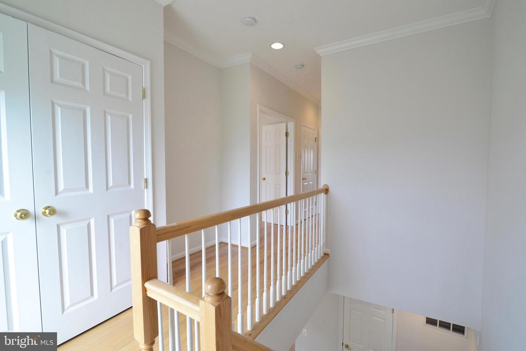 Upper level landing and doors to laundry area - 12144 CHANCERY STATION CIR, RESTON