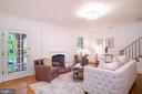 Living room with wood burning fireplace - 3631 VAN NESS ST NW, WASHINGTON