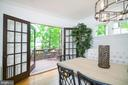 French doors open onto the rear deck - 3631 VAN NESS ST NW, WASHINGTON