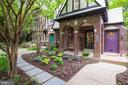 Front porch featuring brick archways - 3631 VAN NESS ST NW, WASHINGTON