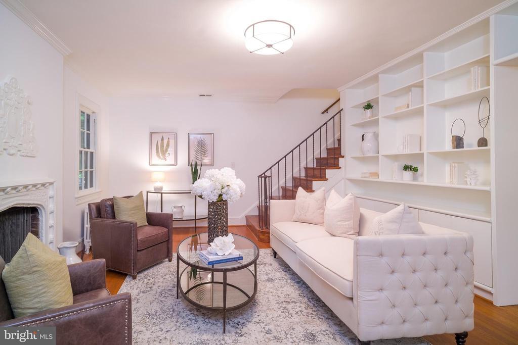 Bright living room with built-in bookshelves - 3631 VAN NESS ST NW, WASHINGTON