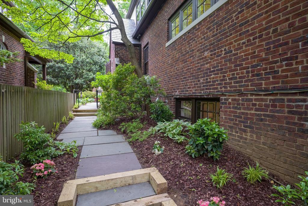 Backyard  wraps around the side of the house - 3631 VAN NESS ST NW, WASHINGTON