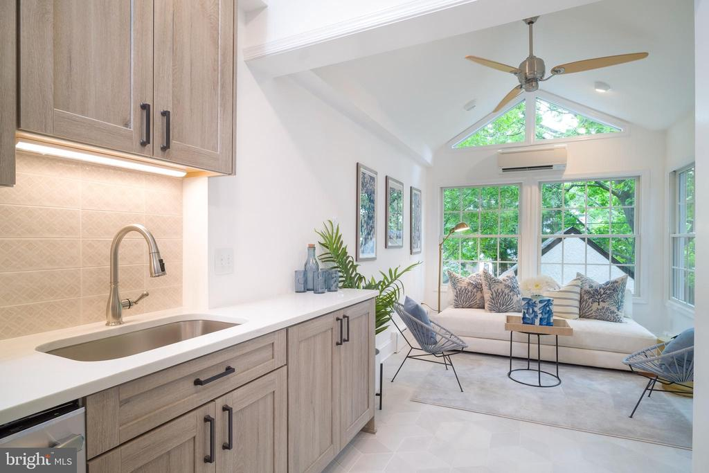 The kitchen flows perfecting into the solarium - 3631 VAN NESS ST NW, WASHINGTON
