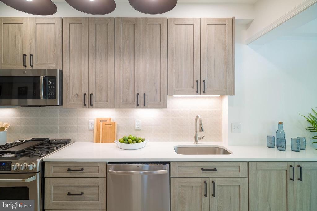 White washing cabinets accent the kitchen - 3631 VAN NESS ST NW, WASHINGTON