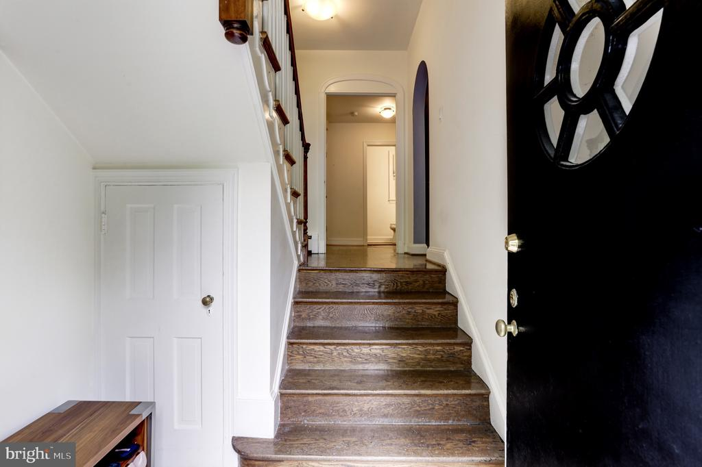Foyer with bench and under stair storage - 4700 RESERVOIR RD NW, WASHINGTON