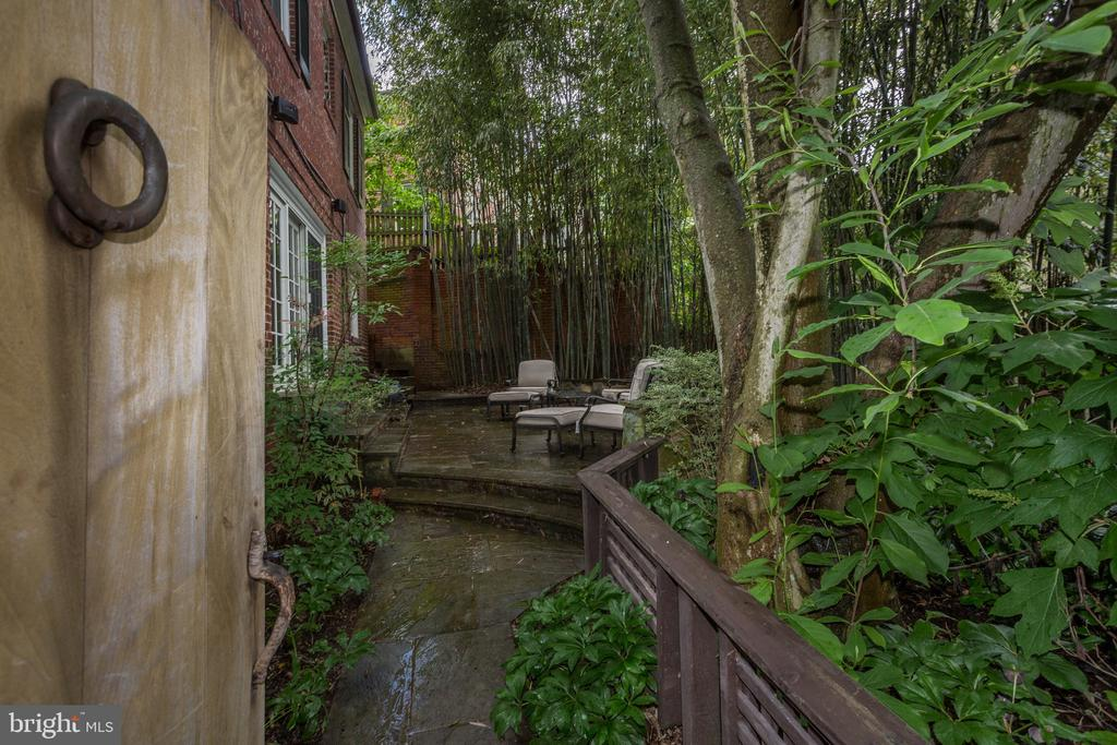 Garden gate opens to private lower patio area - 4700 RESERVOIR RD NW, WASHINGTON