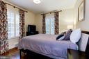 Spacious master bedroom with lush garden views - 4700 RESERVOIR RD NW, WASHINGTON