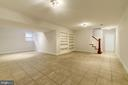 Step down to lower level LARGE tiled rec room area - 3856 N RIXEY ST, ARLINGTON