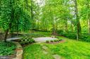 Approach your lower patio and beautiful lawn space - 3856 N RIXEY ST, ARLINGTON