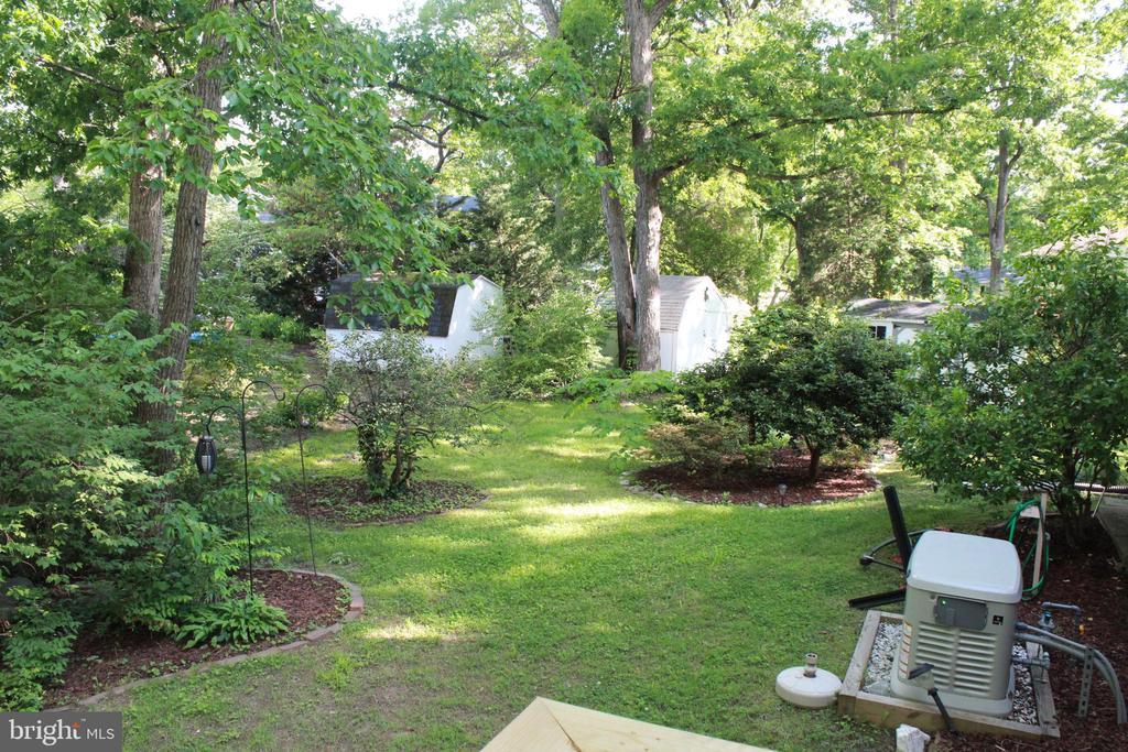 Backyard, showing whole-house generator - 9005 CHERRYTREE DR, ALEXANDRIA