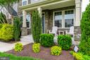 Curb appeal galore w/ inviting stone front porch - 24496 LENAH TRAILS PL, ALDIE
