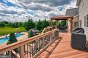 Trex deck with room to barbeque off of the kitchen - 41045 STUMPTOWN RD, WATERFORD