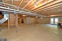 Unfinished basement with rough in for full bath - 20257 REDROSE DR, STERLING