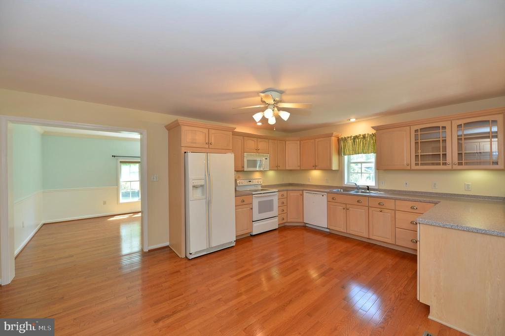 Kitchen with Corian countertops - 20257 REDROSE DR, STERLING