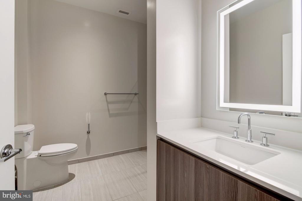 Bathroom with quartz and Porcelanosa tiller's - 1745 N ST NW #102, WASHINGTON