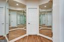Mirrored Dressing Area with walk-in closet - 10010 HIGH HILL PL, GREAT FALLS