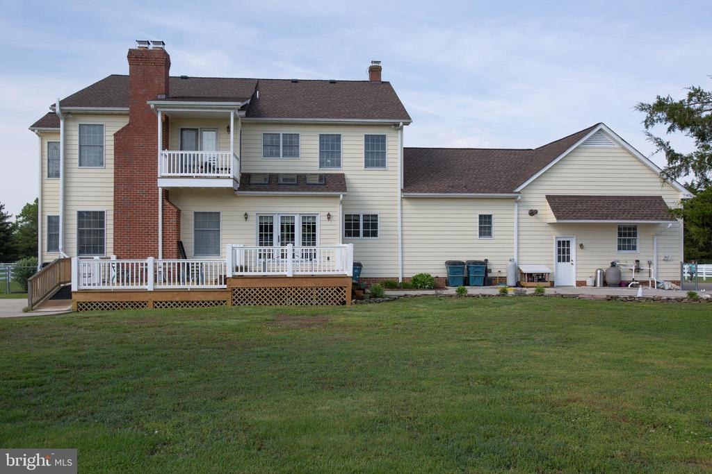 Back side with deck, patio and balcony from MBR - 7411 SNOW HILL DR, SPOTSYLVANIA