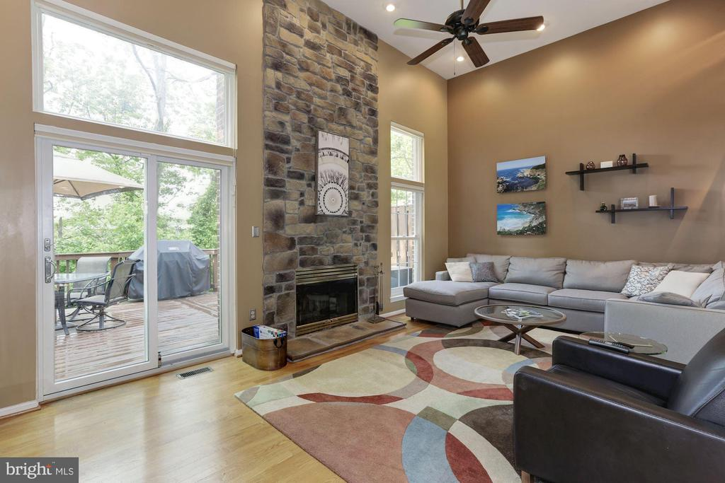 Living room with floor to ceiling stone fireplace - 5912 EDSON LN, ROCKVILLE