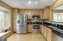 Kitchen with granite and stainless steel - 5912 EDSON LN, ROCKVILLE