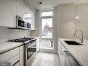 Gourmet kitchen with gas cooking and a window! - 1745 N ST NW #605, WASHINGTON