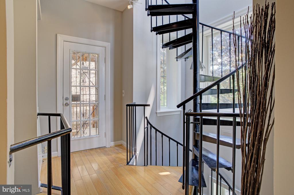 spiral staircase with view of 2nd level door - 834 11TH ST NE, WASHINGTON