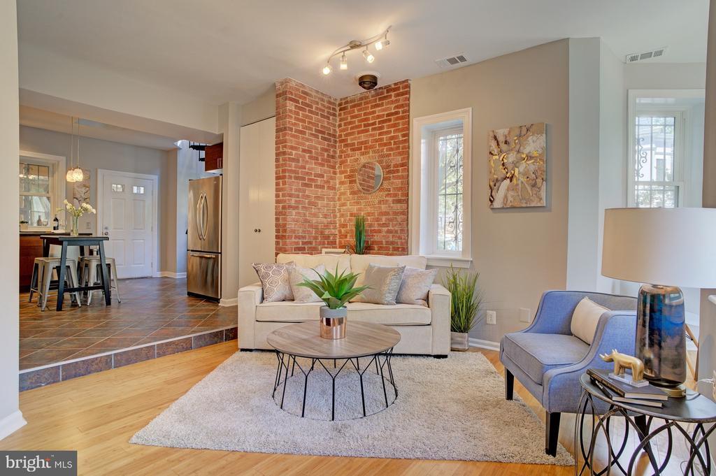 main living area with open floor plan to kitchen - 834 11TH ST NE, WASHINGTON