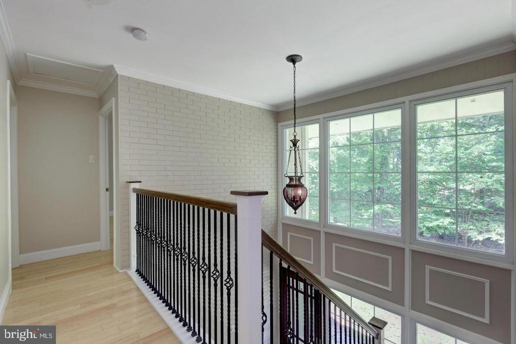 Wrought iron staircase overlook to foyer - 3206 FOX MILL RD, OAKTON