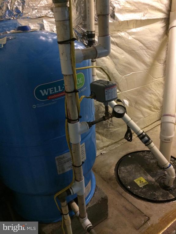 Well tank, sump pump, & radon vent pipe - 12302 HUNGERFORD MANOR CT, MONROVIA