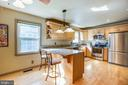 Kitchen with Granite Counters and Breakfast Bar - 141 CHOPTANK RD, STAFFORD