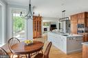 Renovated kitchen with seating area, open format. - 3752 THOMAS POINT RD, ANNAPOLIS