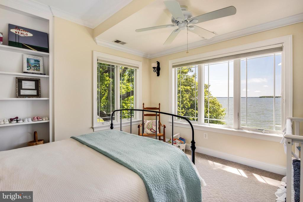 Bedroom with walk in closet and water views. - 3752 THOMAS POINT RD, ANNAPOLIS