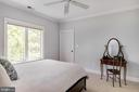 Bedroom with walk-in closet and water views. - 3752 THOMAS POINT RD, ANNAPOLIS