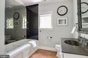Shared full bath with generous tub size. - 3752 THOMAS POINT RD, ANNAPOLIS