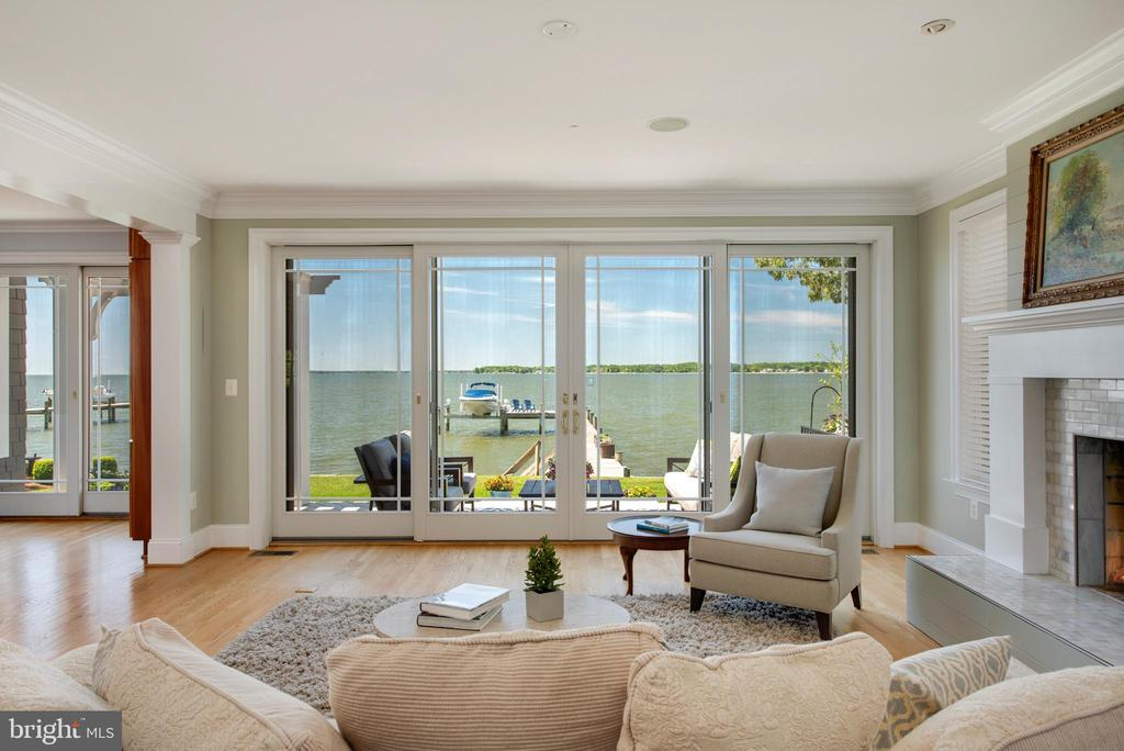 Family room with water views & wood burning FP. - 3752 THOMAS POINT RD, ANNAPOLIS