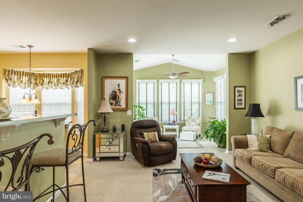 View of Family Room Towards Kitchen and Sunroom - 16096 DANCING LEAF PL, DUMFRIES