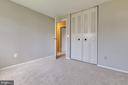 Ample closet in upper back bedroom - 9404 WROUGHT IRON CT, FAIRFAX