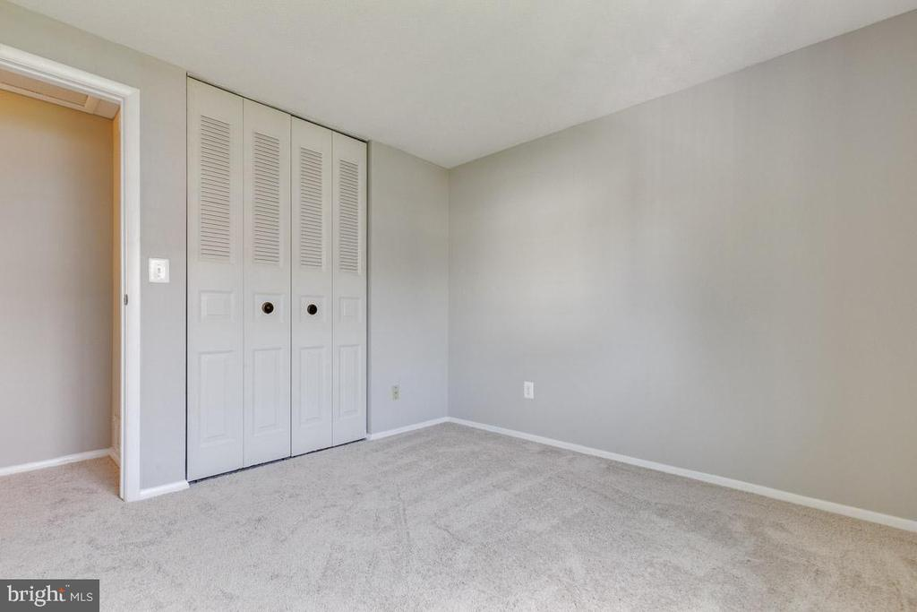 Nice sized closet in upper back bedroom - 9404 WROUGHT IRON CT, FAIRFAX