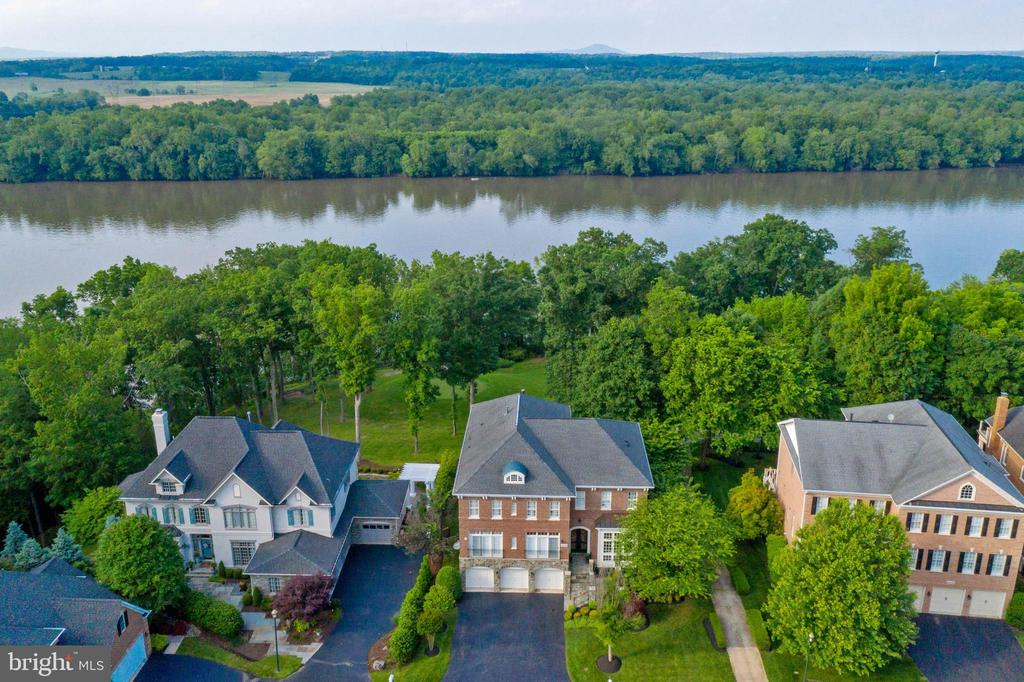 View of Home backing to Potomac River - 18184 SHINNIECOCK HILLS PL, LEESBURG