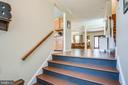 Wood steps in the entrance foyer - 400 WATERS COVE CT, STAFFORD