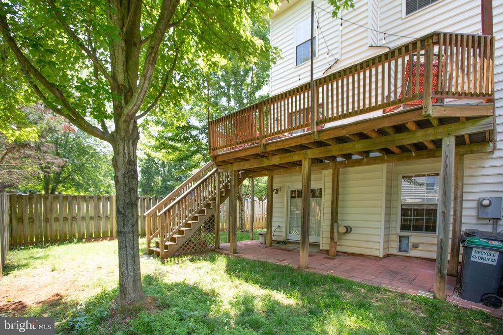 Back showing the deck - 400 WATERS COVE CT, STAFFORD
