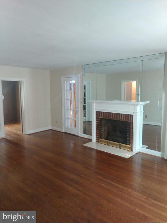Spacious living room with fireplace - 1831 UPSHUR ST NE, WASHINGTON
