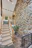 Exposed Stone Walls leading to Lower Level - 39455 DIGGES VALLEY RD, HAMILTON