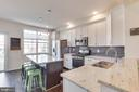 Gourmet Kitchen-Beautiful Glass Tile backsplash - 23143 FLORA MURE DR, ASHBURN